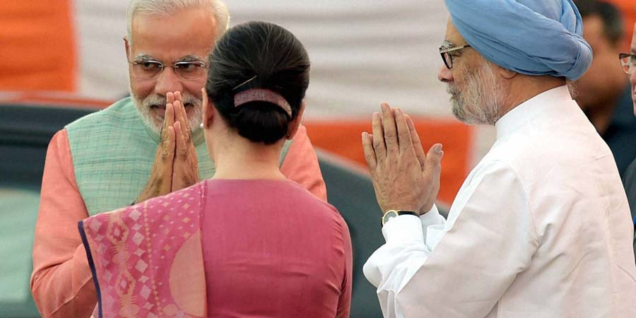 New Delhi: Prime Minister Narendra Modi greets Congress President Sonia Gandhi and former PM Manmohan Singh during Dussehra celebrations at Subhash Maidan in New Delhi on Friday. PTI Photo by Manvender Vashist(PTI10_3_2014_000168B)