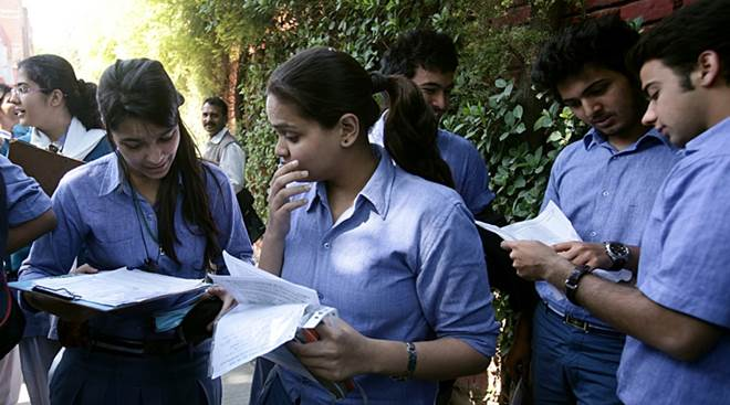 Students discuss as they come out after appearing in the 12th standard exam of CBSE board at a centre in New Delhi on Friday Express Photo By Amit Mehra 01 March 2013